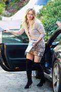 http://img297.imagevenue.com/loc413/th_598992257_Hillary_Duff_going_to_work_LA2_122_413lo.jpg