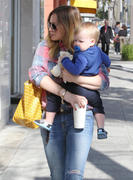 http://img297.imagevenue.com/loc515/th_443295835_Hilary_Duff_Out_and_About_with_Luca37_122_515lo.jpg