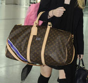 Dakota Fanning in knee highs departs Heathrow Airport in London 09/16/12 (HQ)